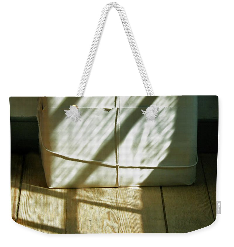 Package Weekender Tote Bag featuring the photograph Mysterious Package by Jill Battaglia