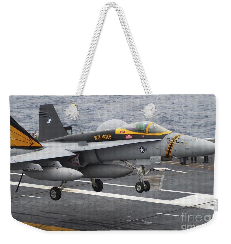 F-18 Super Hornet Weekender Tote Bag featuring the photograph N Fa-18f Super Hornet Lands Aboard by Stocktrek Images