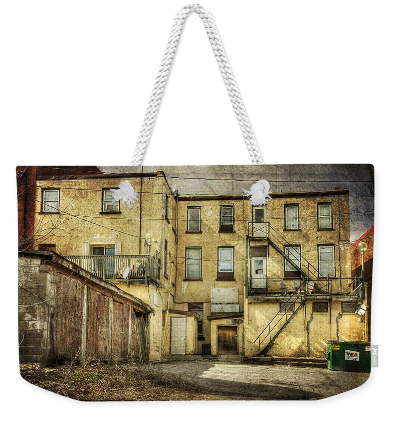 Acrylic Prints Weekender Tote Bag featuring the photograph Napanee High Rise by John Herzog