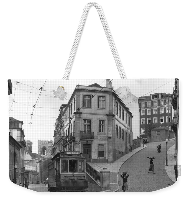 Day Weekender Tote Bag featuring the photograph Narrow Streets And Streetcar In Lisbon by W Robert Moore