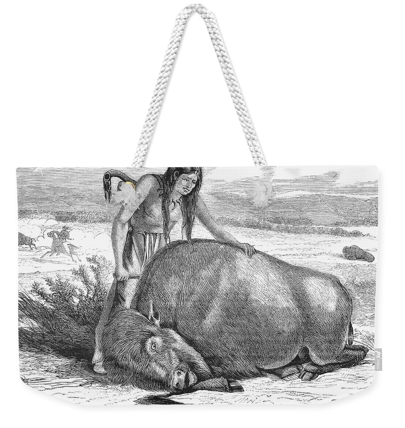 19th Century Weekender Tote Bag featuring the photograph Native Amerians: Cutting Buffalo by Granger