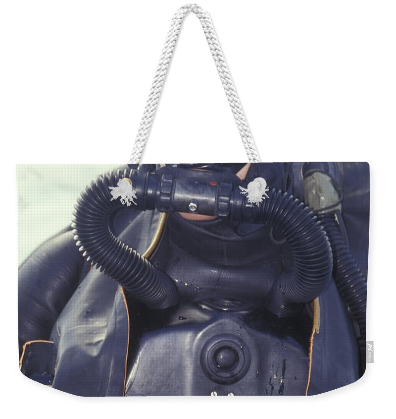 fdd75c2361a Looking Away Weekender Tote Bag featuring the photograph Navy Seal Combat  Swimmer Wearing by Michael Wood