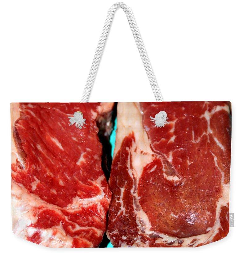 new York Weekender Tote Bag featuring the photograph New York Steak Raw by Henrik Lehnerer