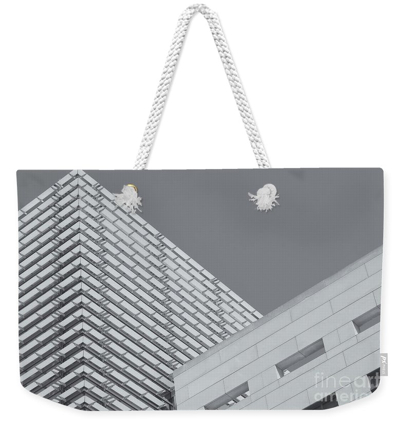 Clarence Holmes Weekender Tote Bag featuring the photograph Newseum Contrasting Facades II by Clarence Holmes