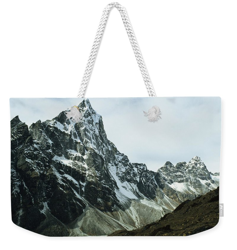 Color Image Weekender Tote Bag featuring the photograph North Face Of Cholatse Peak Towers by Gordon Wiltsie