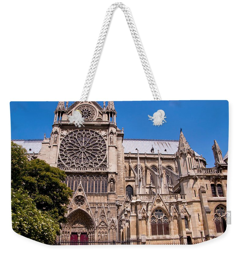 France Weekender Tote Bag featuring the photograph Notre Dame Cathedral Rose Window by Jon Berghoff