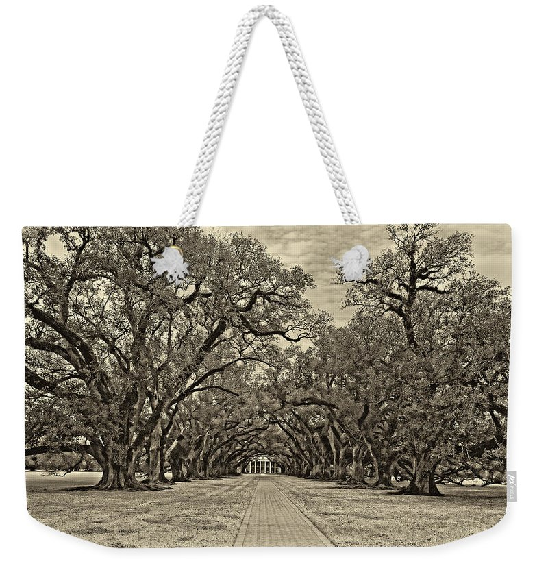 Oak Alley Plantation Weekender Tote Bag featuring the photograph Oak Alley 3 Antique Sepia by Steve Harrington