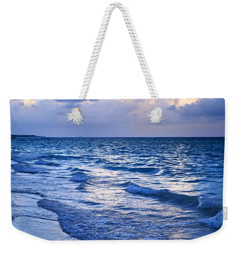 Sunrise Weekender Tote Bag featuring the photograph Ocean Waves On Beach At Dusk by Elena Elisseeva