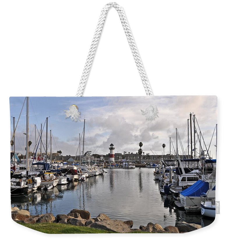 Light House Weekender Tote Bag featuring the photograph Oceaside Harbor by Bridgette Gomes