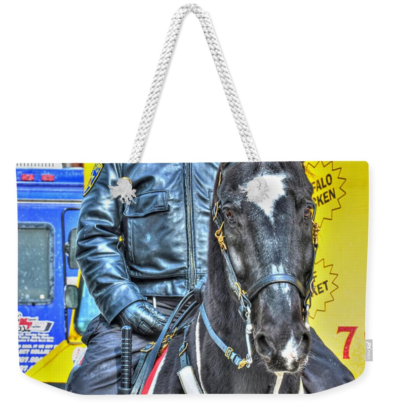 Weekender Tote Bag featuring the photograph Officer And Black Horse by Michael Frank Jr