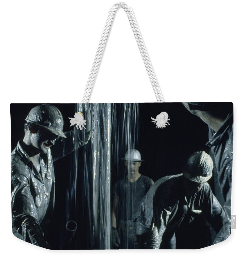 Color Image Weekender Tote Bag featuring the photograph Oilmen Covered In Mud Pull Up A Drill by David Boyer