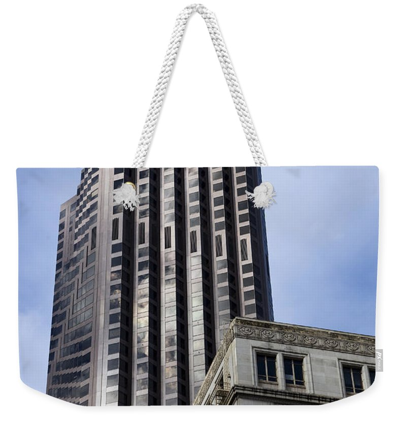No People Weekender Tote Bag featuring the photograph Old Architecture Is Juxtaposed by Pete Ryan