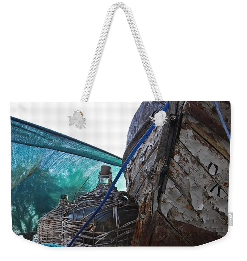 Boat Weekender Tote Bag featuring the photograph Old Boat And Flagons by Andy Prendy