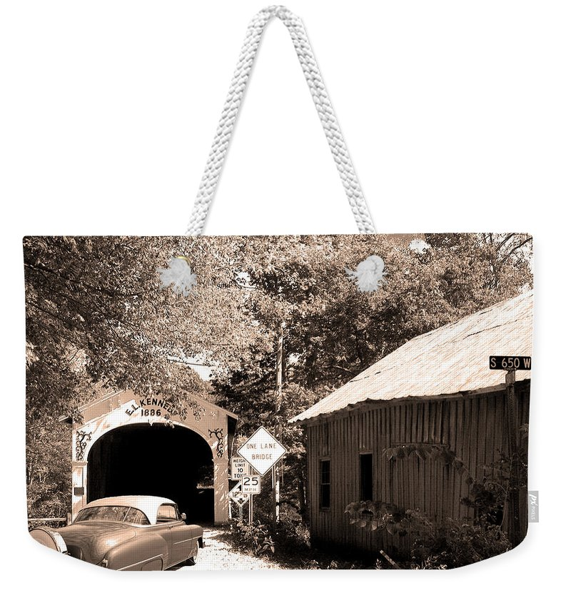 Old Chevy Weekender Tote Bag featuring the photograph Old Car Older Barn Oldest Bridge by Randall Branham