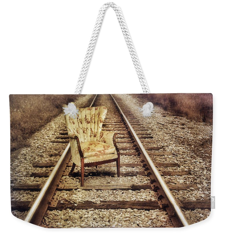 Chair Weekender Tote Bag featuring the photograph Old Chair On Railroad Tracks by Jill Battaglia
