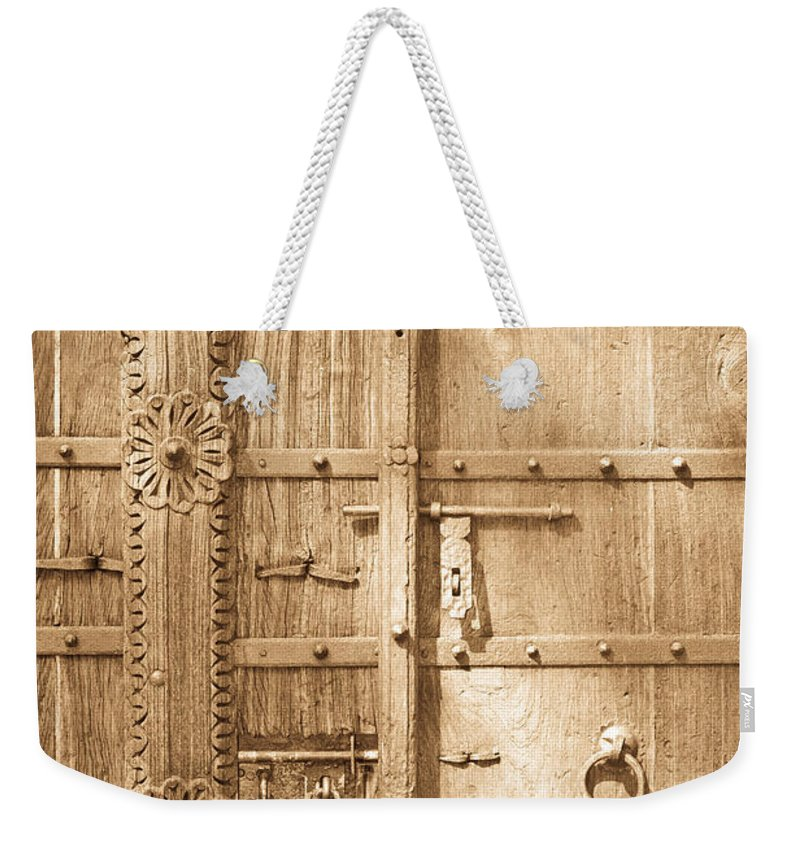 Antique Weekender Tote Bag featuring the photograph Old Door by Tom Gowanlock