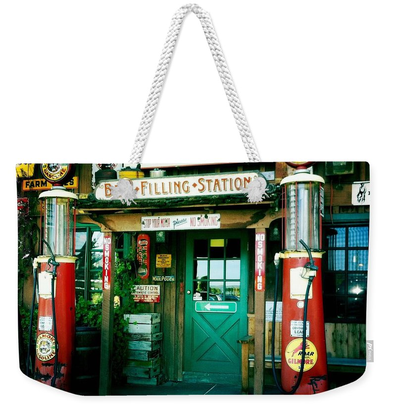 Photograph Weekender Tote Bag featuring the photograph Old Fashioned Filling Station by Nina Prommer