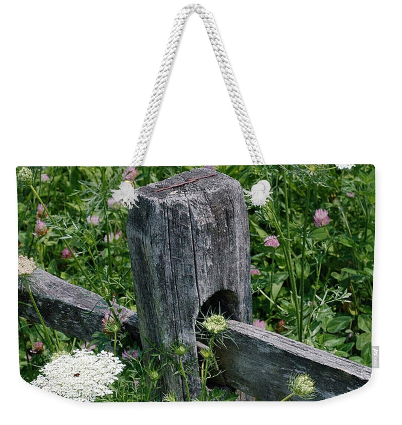 Old Weekender Tote Bag featuring the photograph Old Fence And Wildflowers by Mike Nellums