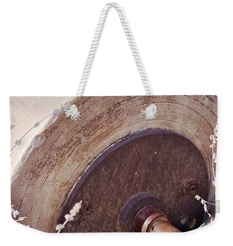 Grinding Wheel Weekender Tote Bag featuring the photograph Old Grinding Wheel by Phyllis Denton