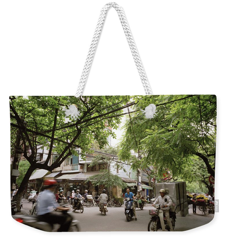Asia Weekender Tote Bag featuring the photograph Old Hanoi Life by Shaun Higson