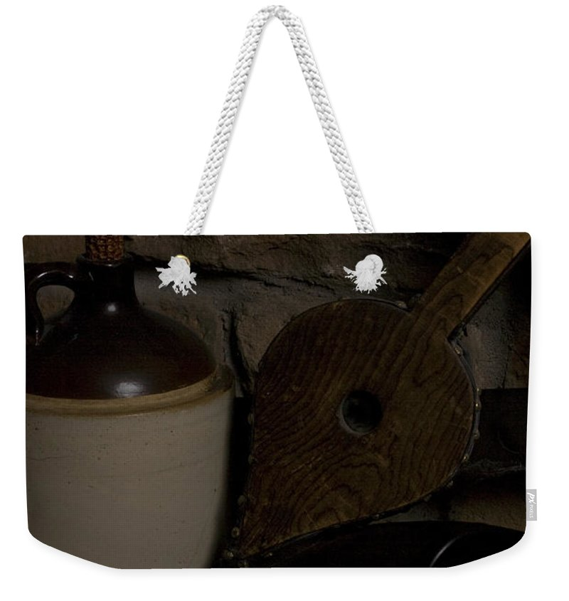 Antique Weekender Tote Bag featuring the photograph Old Items On A Stone Hearth 1 by Alan Look