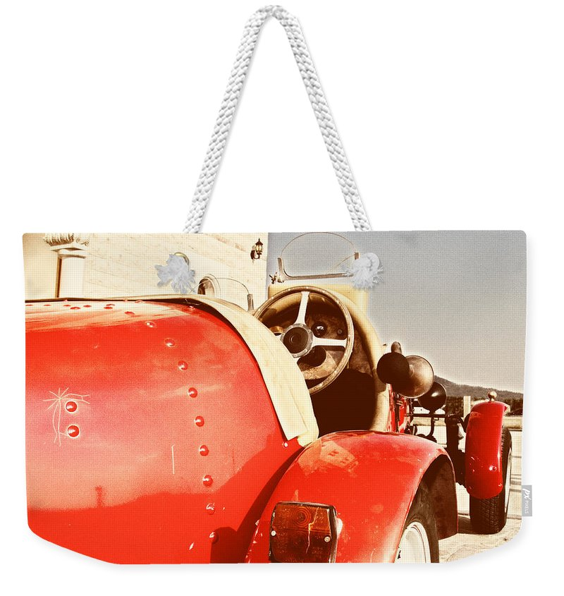 Antique Weekender Tote Bag featuring the photograph old Red Race Car by Stelios Kleanthous