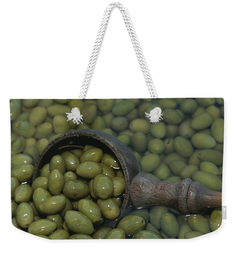 Plants Weekender Tote Bag featuring the photograph Olives Being Processed In Provence by Nicole Duplaix