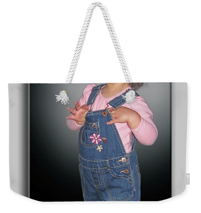 2d Weekender Tote Bag featuring the photograph Olivia by Brian Wallace