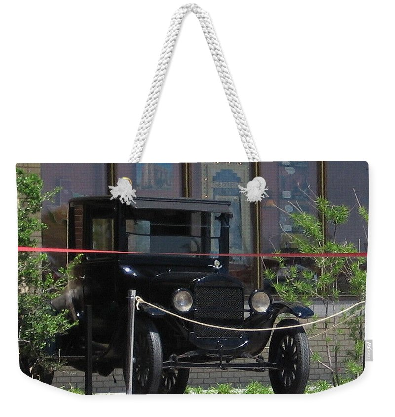 Antique Weekender Tote Bag featuring the photograph On Display by Amy Hosp