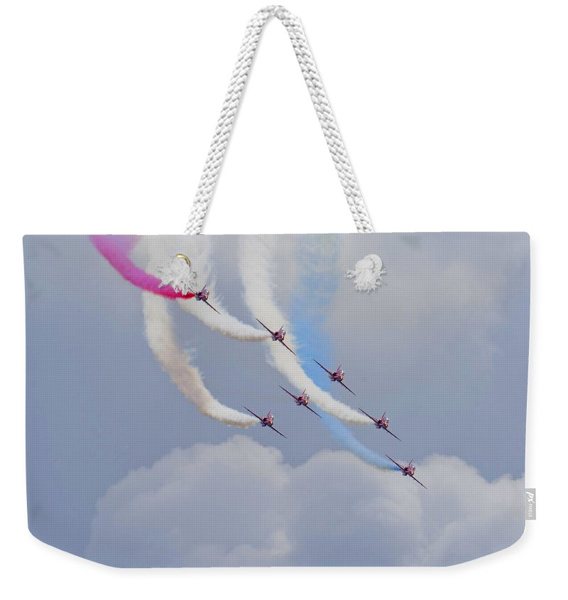 Red Weekender Tote Bag featuring the photograph On The Curve by Dave Godden