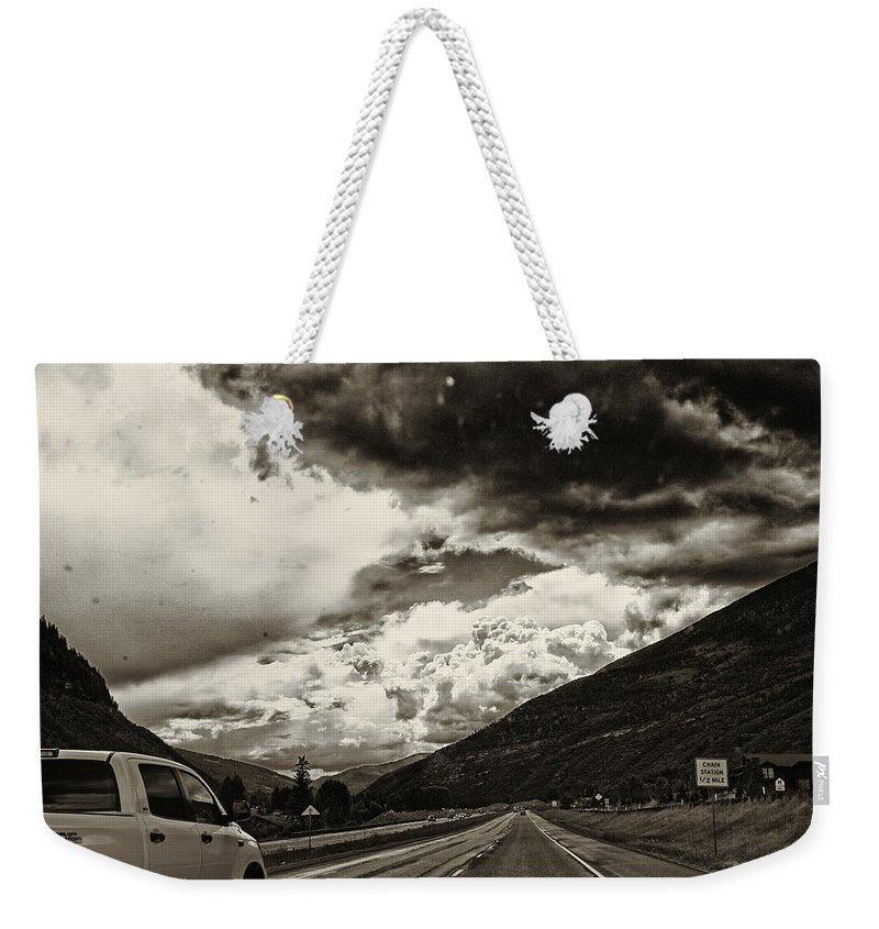 Road Weekender Tote Bag featuring the photograph On The Road Again by Madeline Ellis