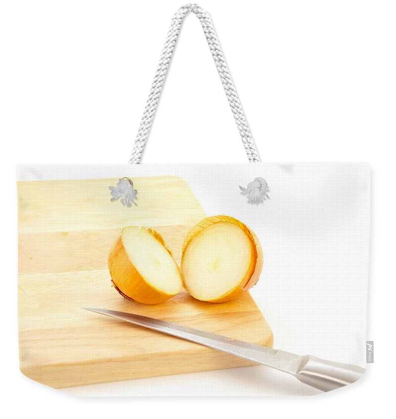 Allium Weekender Tote Bag featuring the photograph Onion by Tom Gowanlock