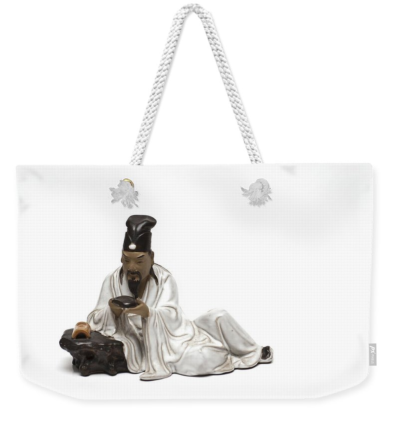 Oriental Warrior Weekender Tote Bag featuring the photograph Oriental Warrior At Rest by Steve Purnell