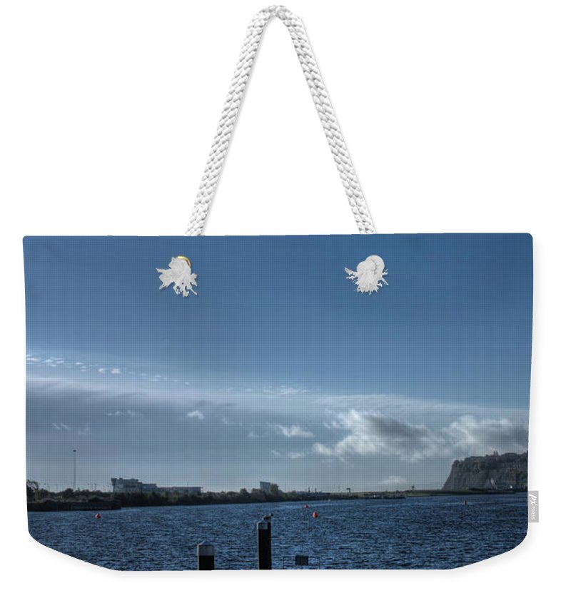 Landing Jetty Weekender Tote Bag featuring the photograph Out Into The Bay by Steve Purnell