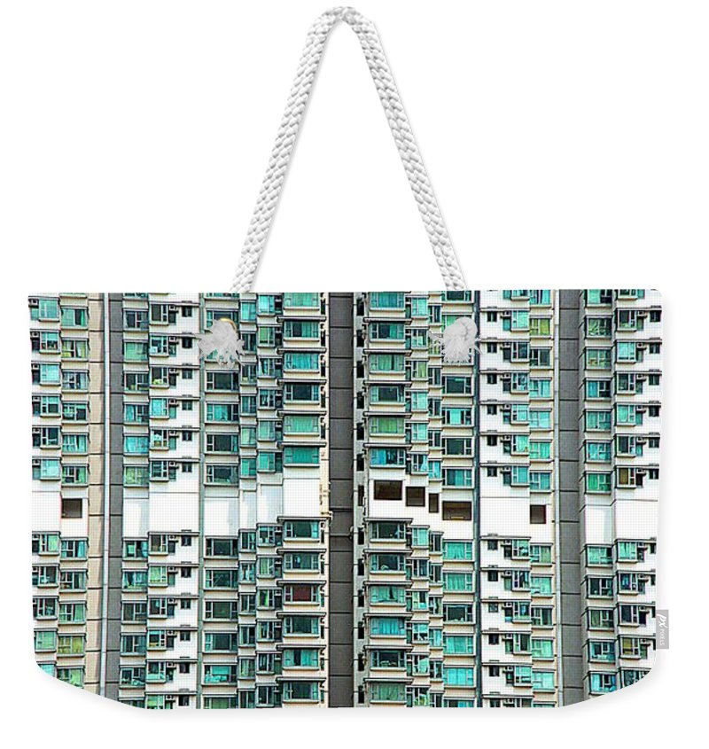 Overpopulated Weekender Tote Bag featuring the photograph Overpopulation by Valentino Visentini
