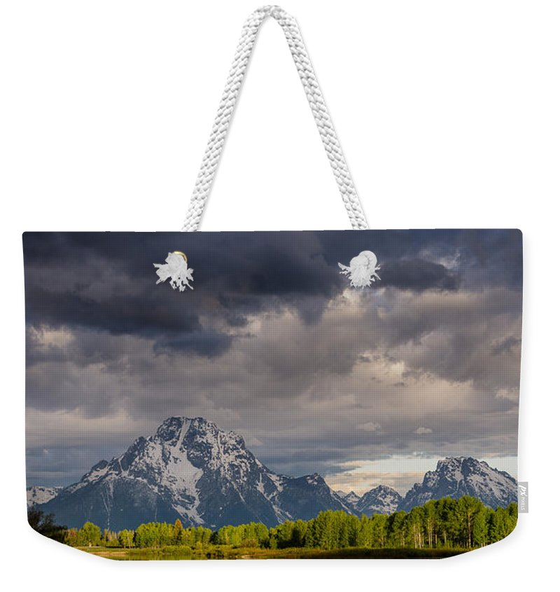 Grand Tetons National Park Weekender Tote Bag featuring the photograph Oxbow Light And Clouds by Greg Nyquist