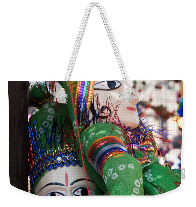 Puppet Weekender Tote Bag featuring the photograph Pair Of Large Puppets At The Surajkund Mela by Ashish Agarwal