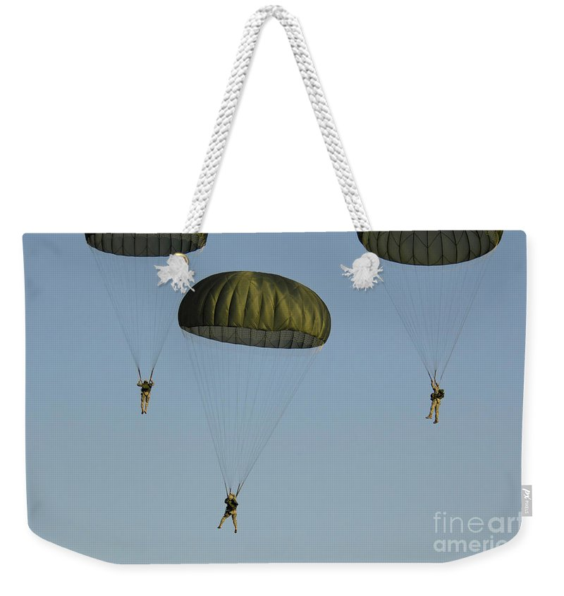 82nd Airborne Division Weekender Tote Bag featuring the photograph Paratroopers Descend Through The Sky by Stocktrek Images