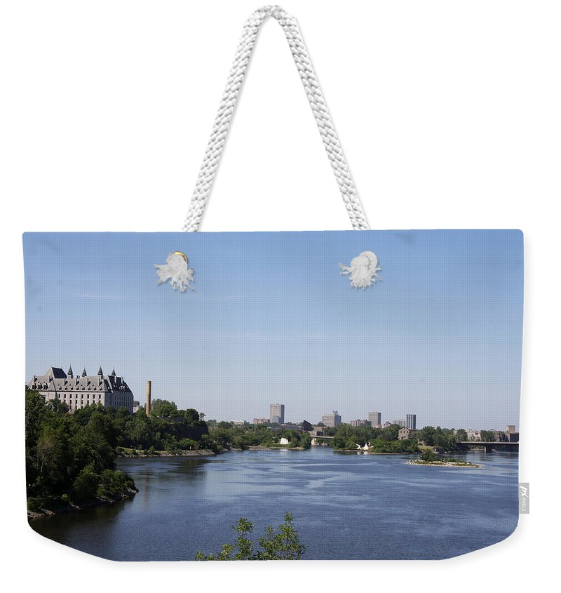 Ottawa River Weekender Tote Bag featuring the photograph Parliament And Ottawa River by Christiane Schulze Art And Photography