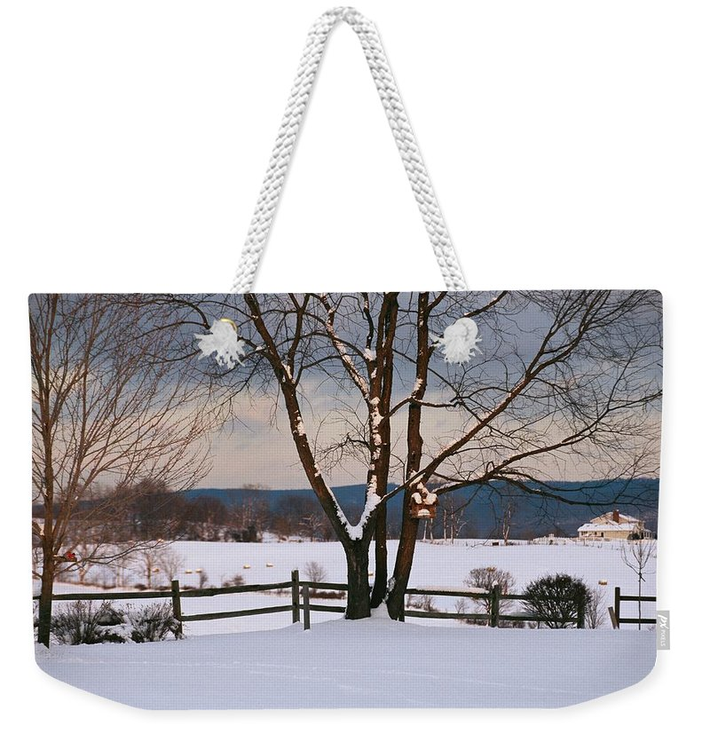 North America Weekender Tote Bag featuring the photograph Pastoral View Of A Farm Covered In Snow by Raymond Gehman