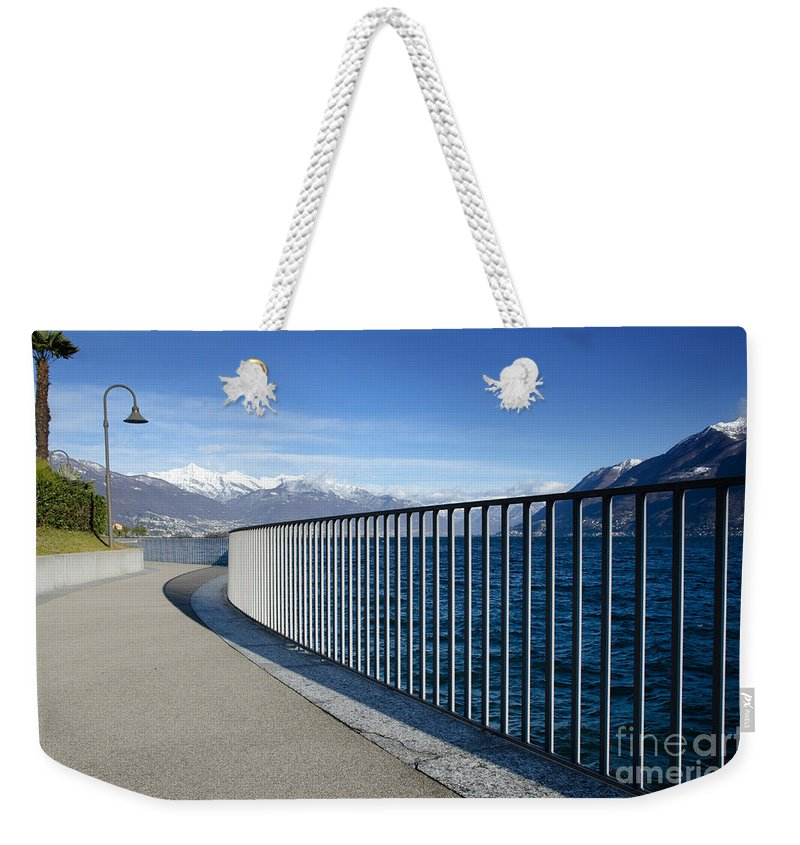 Path Weekender Tote Bag featuring the photograph Path On An Alpine Lakefront by Mats Silvan