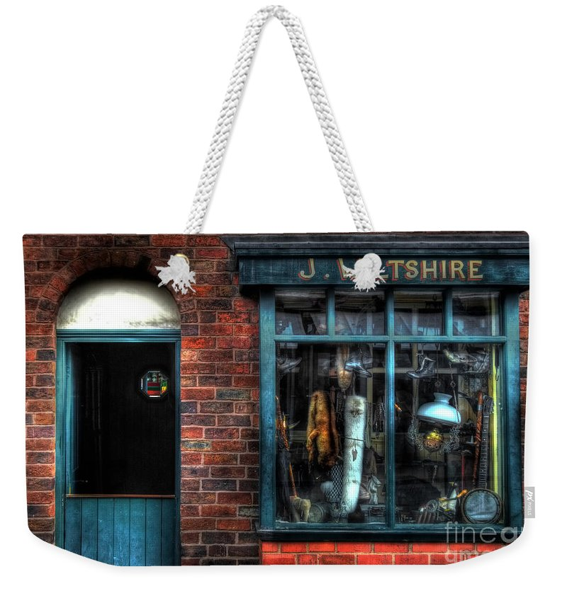 Art Weekender Tote Bag featuring the photograph Pawnbroker's Shop by Yhun Suarez