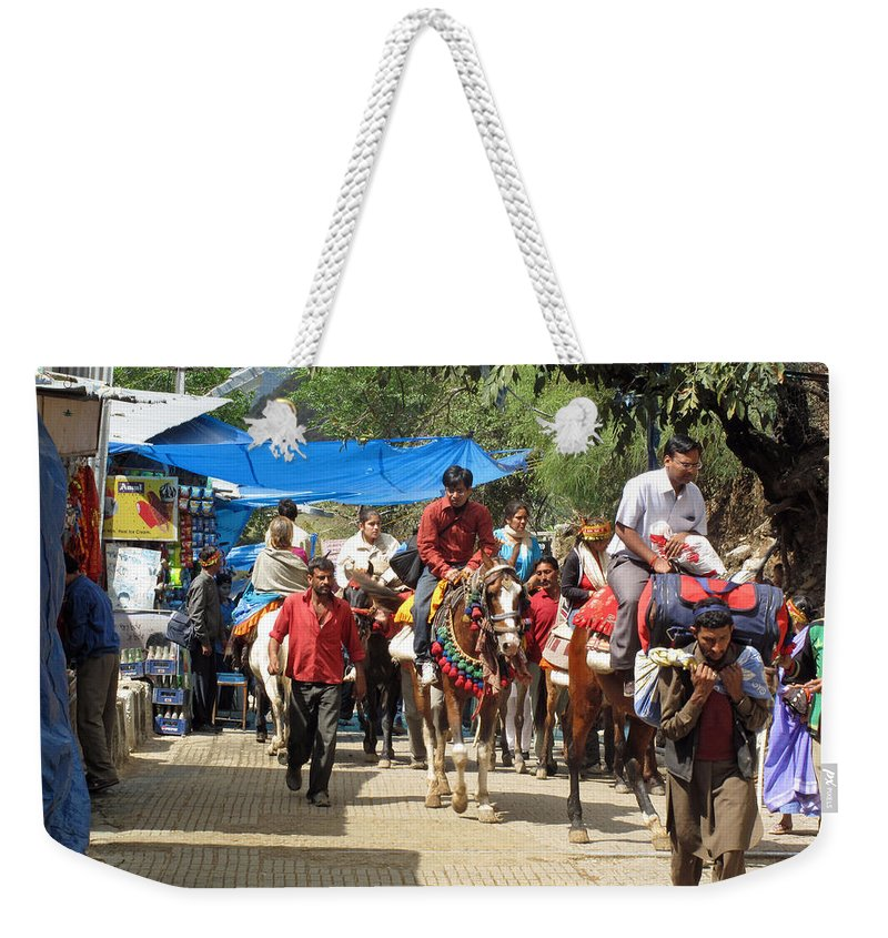 Vaishno Devi Weekender Tote Bag featuring the photograph People On Horseback And On Foot Making The Climb To The Vaishno Devi Shrine In India by Ashish Agarwal