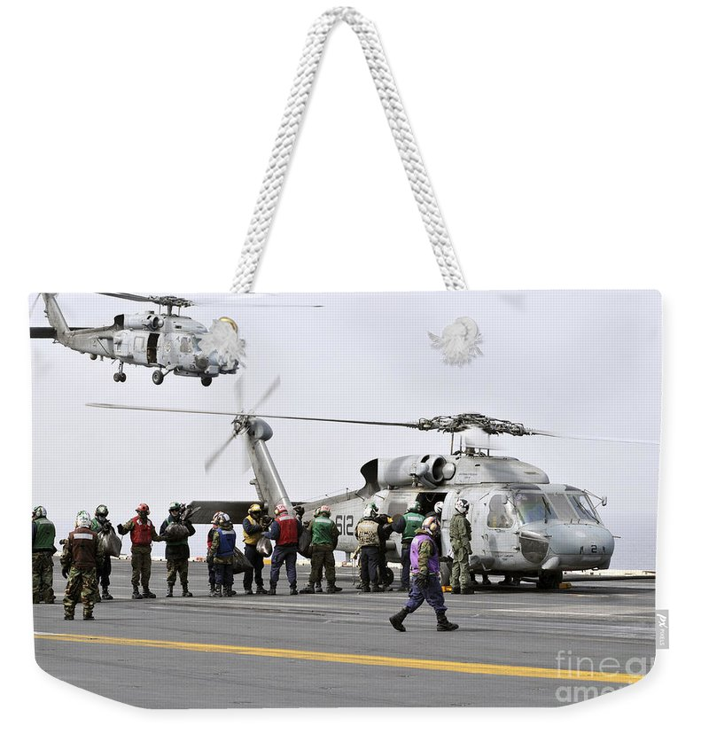 Humanitarian Supplies Weekender Tote Bag featuring the photograph Personnel Load Humanitarian Supplies by Stocktrek Images