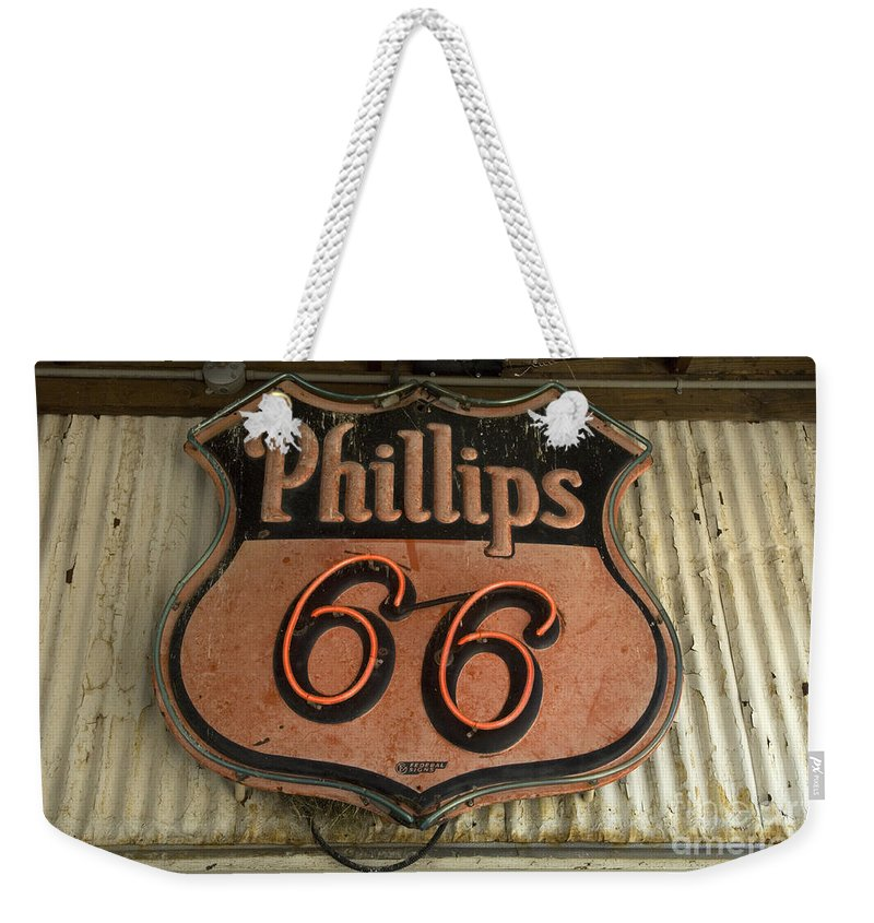Route 66 Weekender Tote Bag featuring the photograph Phillips 66 Vintage Sign by Bob Christopher