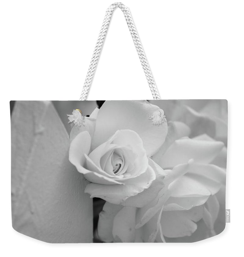 Black & White Weekender Tote Bag featuring the photograph Picket Rose by Peter Tellone