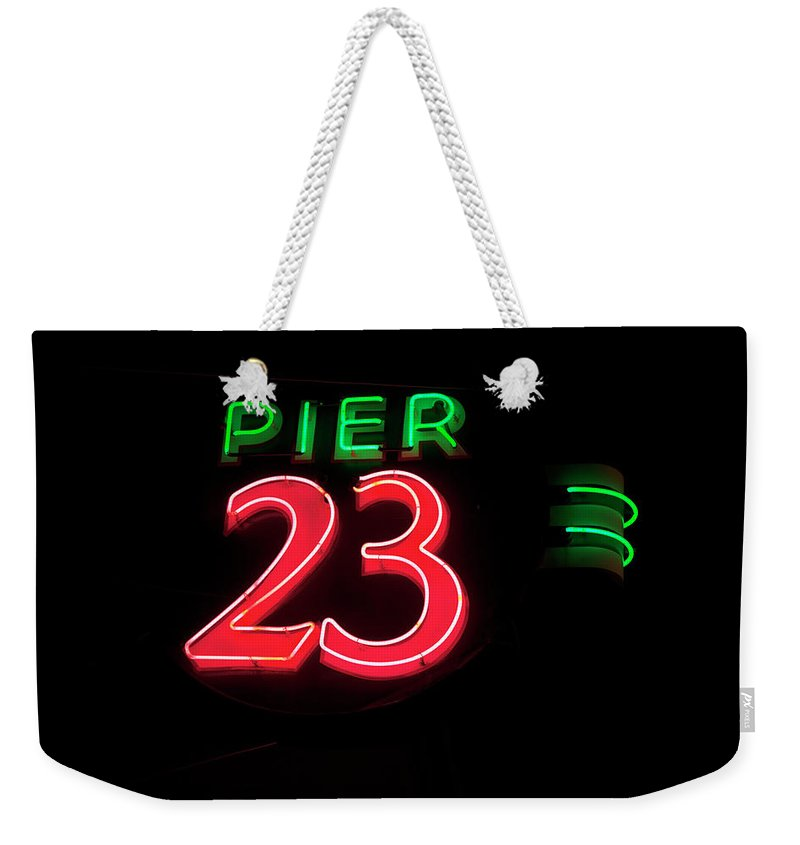 Neon Weekender Tote Bag featuring the photograph Pier 23 Neon by John Stephens