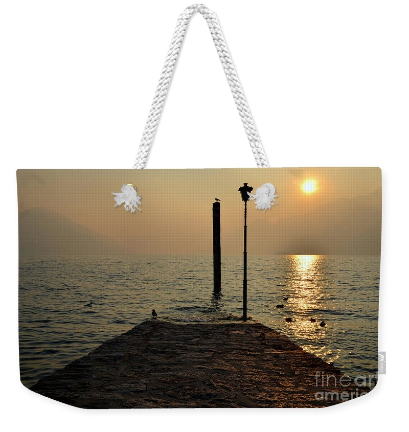 Pier Weekender Tote Bag featuring the photograph Pier And Sunset by Mats Silvan
