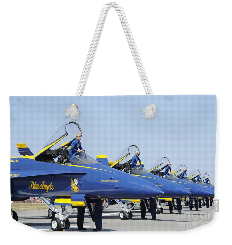 Blue Angels Weekender Tote Bag featuring the photograph Pilots Of The Blue Angels Flight by Stocktrek Images