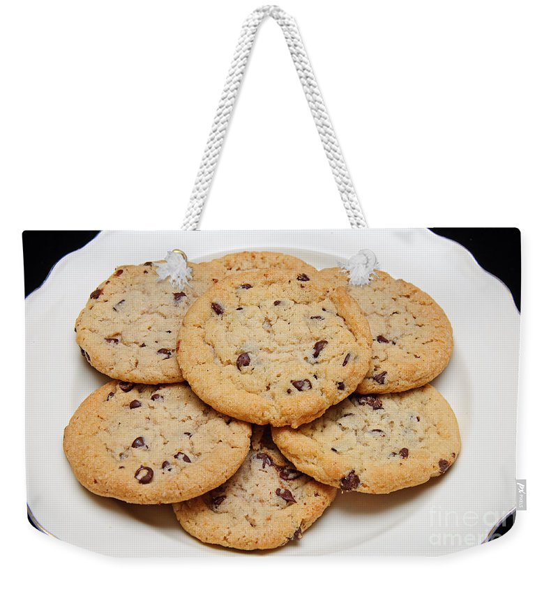 Fine Art Food Weekender Tote Bag featuring the photograph Plate Of Chocolate Chip Cookies by Andee Design
